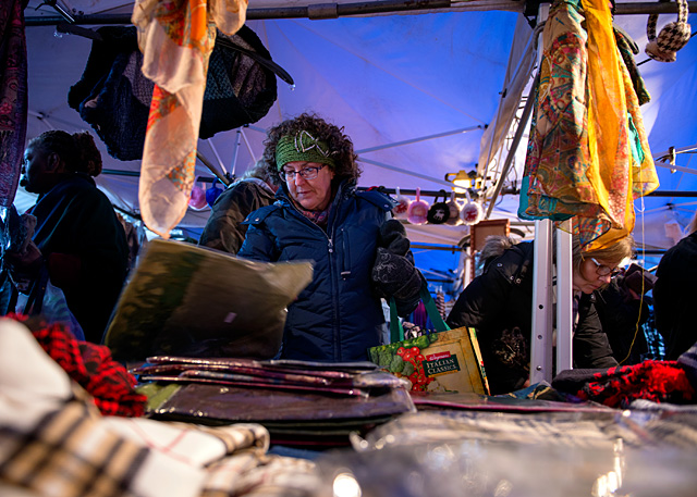 Mary Sue Renfro shops clothing at the Rochester Public Market's Holiday at the Market Dec. 4.