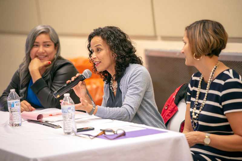 "Mary Méndez Rizzo (center) speaks during a panel discussion, joined by Jackie Ortiz (left) and Vilma Patterson (right) at the Oct. 11 ""RISE Up Latina"" workshop at Rochester's Martin Luther King Jr. Park's lodge."