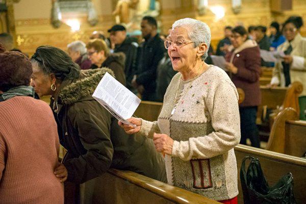 A woman sings in church.