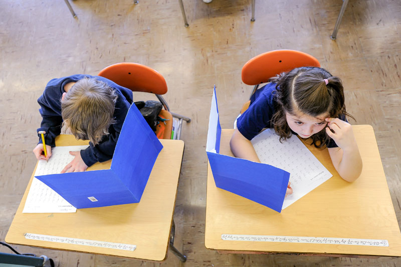 Students take a test at St. Pius Tenth School in Chili Feb. 18, 2011