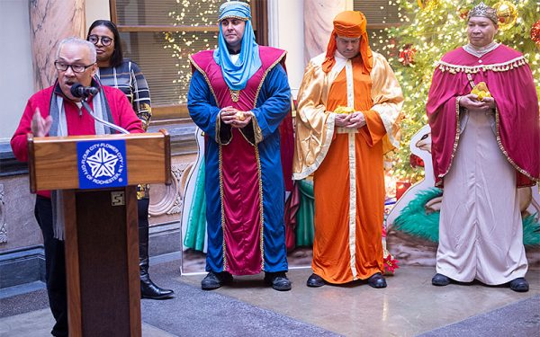 Hector Arguinzoni explains the history Three Kings Day and how it is celebrated in Puerto Rico during a celebration of the feast day at Rochester City Hall Jan 6. (EMC photo by John Haeger)