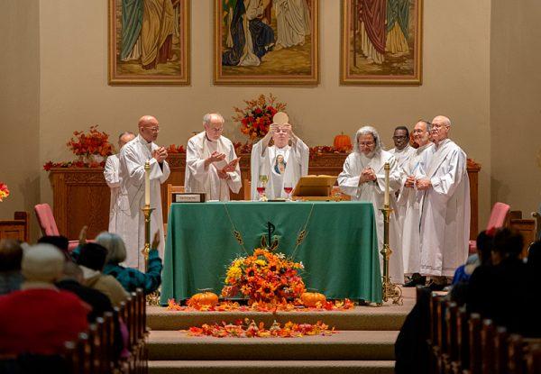 Priests hold Mass.