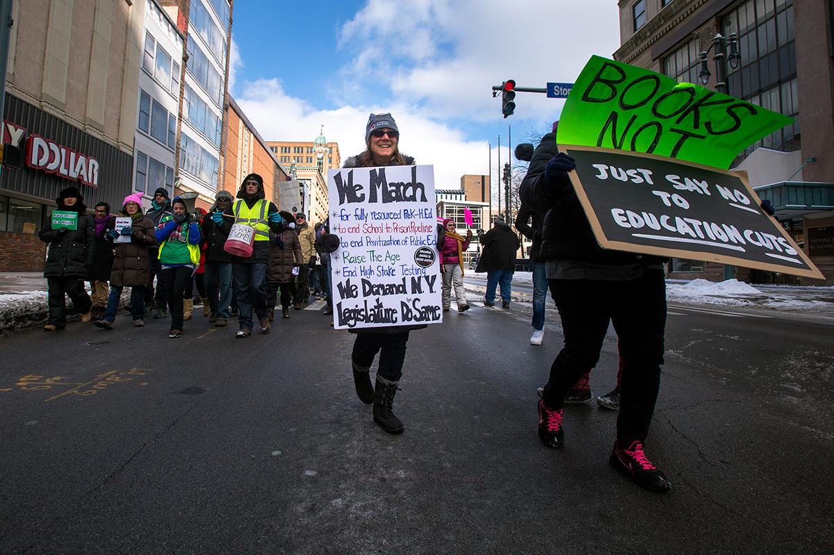 Lisa Englert marches down Main Street in Rochester during a March 4 rally against Gov. Andrew Cuomo's proposed education budget.