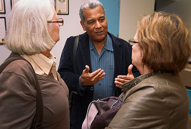 Luis Barrios talks with Grania Marcus, left, and Dorothy Romanet after speaking about the complexity of immigration policy Sept. 28 at Workers United Hall. An Episcopal priest and chair of the Department of Latin American Studies at John Jay College of Criminal Justice in New York City, Barrios was brought to Rochester by the Greater Rochester Coalition for Immigration Justice.
