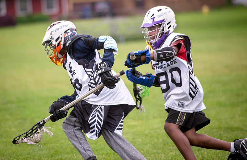 Lacrosse player work on a drill during practice at School 33 on Webster Ave in Rochester on June 5. El Mensajero Photo by John Haeger