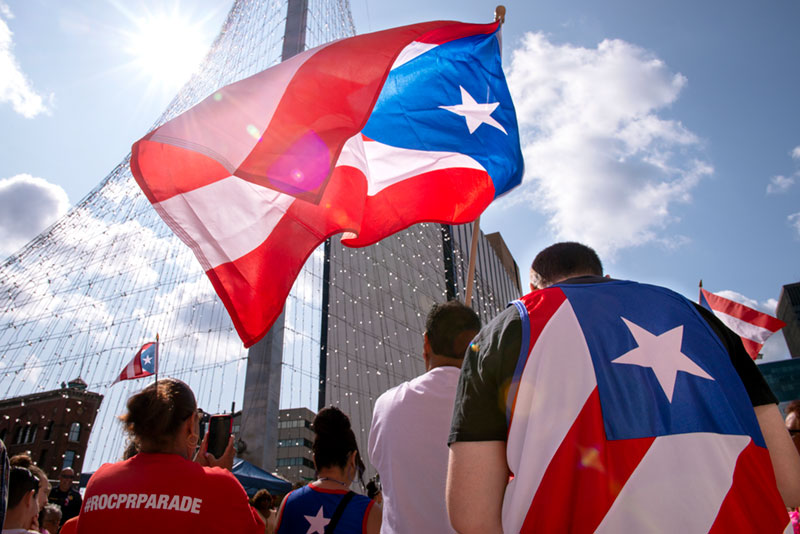A crowd gathers near the Liberty Pole in Rochester for the opening ceremony of the Puerto Rican Parade July 28, 2019.