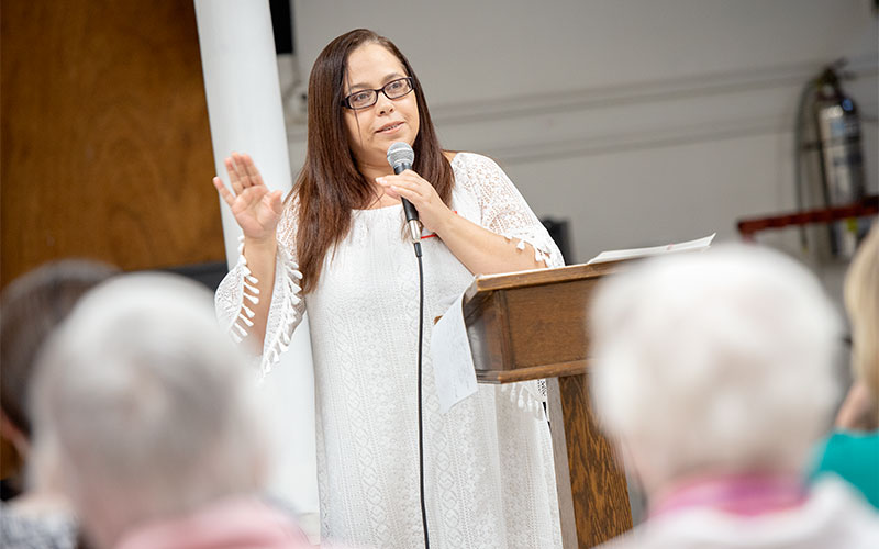 Virgen López speaks on her experience following Hurricane Maria and her decision to flee the island during a May 9 event at Our Lady of the Americas Church in Rochester.