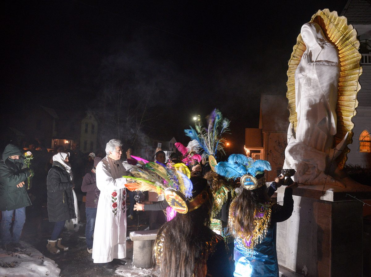 Father Jesús Flores blesses a statue of Our Lady of Guadalupe outside of Our Lady of Guadalupe Church  on Dec. 12 in Marion. (Courier Photo by John Haeger)