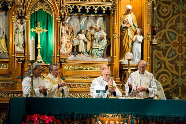 A priest says Mass.