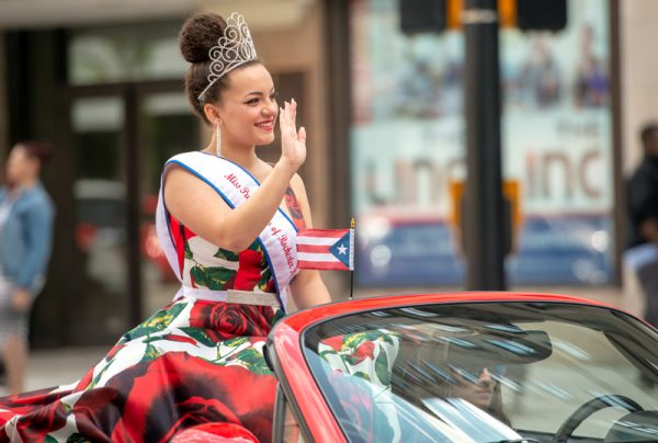 A pageant winner waves in a parade.