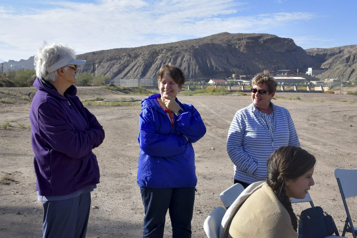 Sr. Kathleen Erickson (from left), Sr. Rita Valade, Barbara Quinlan-Giehl and Rachel Jones (sitting) stand near the Mexico border in El Paso.