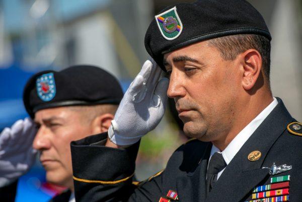 A uniformed man salutes.