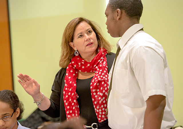 Louise Vella, Director of Workforce and Leadership Development at Unity Health System, prompts 16-year-old Chauncey Mosley, a freshman at Charlotte High School, to tell classmates in Hillside's Youth Employment Training Academy about his strongest qualities May 31. The five-week program provides teenagers with 25 hours of training.