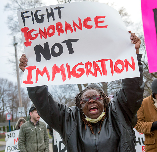 Sallie Williams of the Rochester Workers Center takes part in a March 9 rally at Rochester's Summerville Presbyterian Church in support of Jose Coyote, who has been detained by Immigration and Customs Enforcement. EMC photo by John Haeger