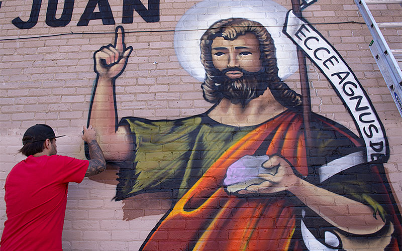 A Mural created by the local graffiti artists FUA Crew l during the Little San Juan festival to honor St. John the Baptist on Aug. 11 at the The Father  Laurence  Tracy  Advocacy Center in Rochester. (EMC photo by John Haeger)