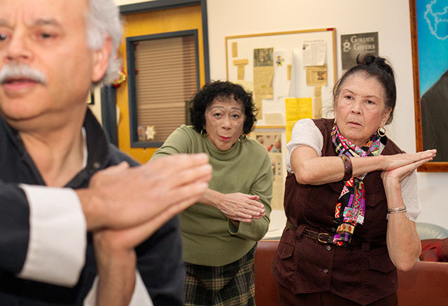 "Bertha Bu Melian (right) and Aliza Gutierrez (center) learn tai chi from Carmelo Ramos during one of several sessions offered for caretakers of patients with Alzheimer's disease during ""El Arte de Cuidar"" Nov. 14 at The Community Place. Ramos, who has been teaching tai chi for over 40 years, said that activity is thought to slow the progression of Alzheimer's disease."