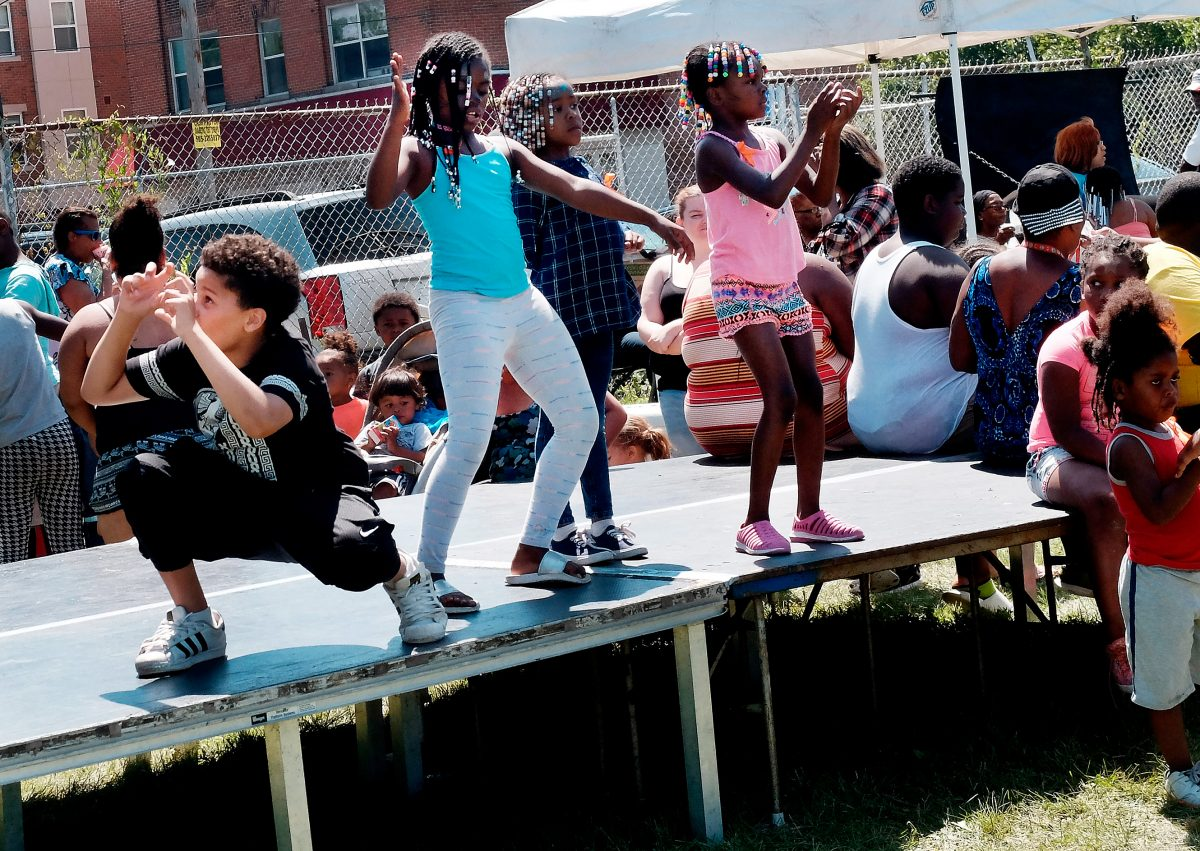 Kids dance on the stage to a DJ during the Joseph Ave Arts Revitalzation Festival in Rochester on July 29. El Mensajero Photo by John Haeger