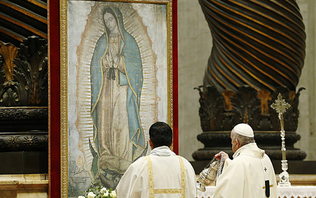 Pope Francis censes an image of Our Lady of Guadalupe during Mass on her feast day, Dec. 12, 2019, in St. Peter's Basilica in the Vatican. The episcopal conference of Latin America, known as CELAM, announced plans to consecrate Latin America and the Caribbean to Our Lady of Guadalupe on Easter, April 12, 2020. (CNS photo by Paul Haring)<strong></strong>