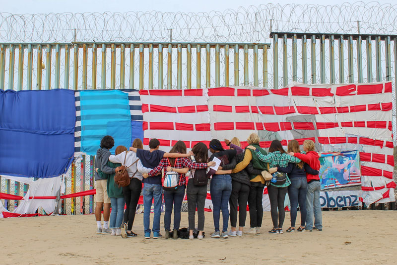 """University of San Diego students take a moment for reflection March 4, 2019, at Parque de la Amistad in Mexico during """"Tijuana Spring Breakthrough,"""" an alternative spring break experience sponsored by the university ministry. (CNS photo/University of San Diego) See USD-SPRING-BREAK March 20, 2019."""