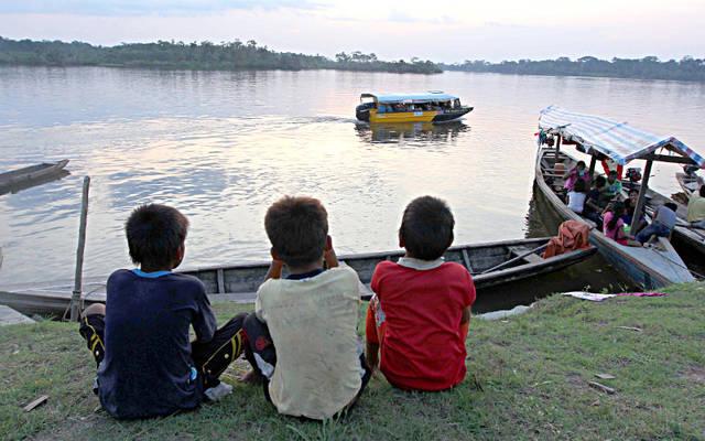 3 boys watch boats