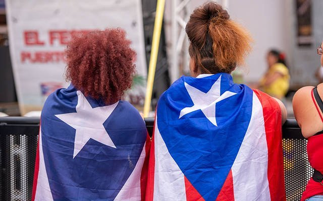 Puerto Rican Festival attendees wear flags as capes Aug. 16, 2019. The festival has been cancelled for the 2020 season. Puerto Rican Festival attendees wear flags as capes Aug. 16, 2019. The festival has been cancelled for the 2020 season. (File photo)