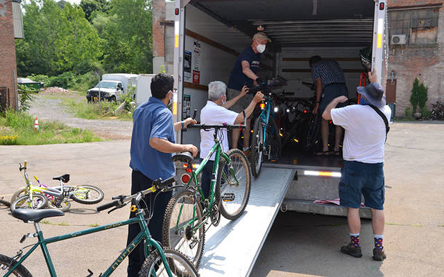 The Diocese of Rochester's migrant ministry team worked with R Community Bikes in Rochester to distribute bikes and helmets to members of the migrant community in Marion in early July. (Photo courtesy of Carmen Rollinson)