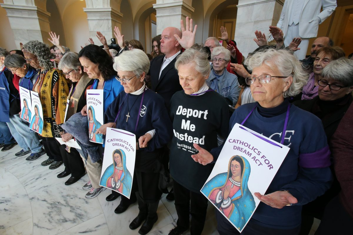 "Sisters of Mercy and others pray inside the Russell Senate Office Building in Washington Feb. 27 during a ""Catholic Day of Action for Dreamers"" protest to press Congress to protect ""Dreamers."" (CNS photo/Bob Roller) See DACA-CONGRESS-CATHOLIC-LEADERS Feb. 27, 2018."