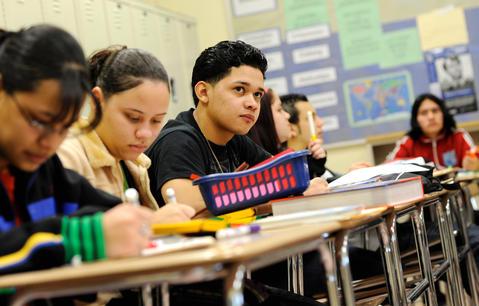 Hispanic students in a bilingual classroom at Monroe High School.