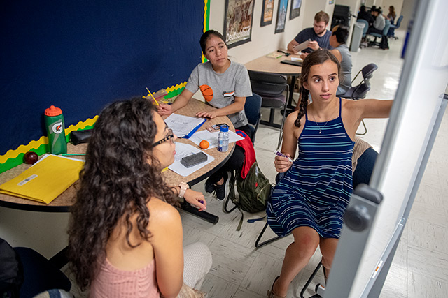 SUNY Geneseo tutor English through the college's Project Together program Sept. 15. The program aims to help the area's Spanish speaking community with their English proficiency while giving students the opportunity to practice their Spanish skills.