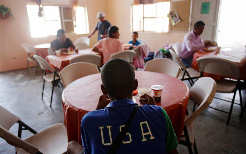 Migrants enjoy a meal inside a shelter in Ciudad Juarez, Mexico, July 10, 2019. Mexican shelter operators report increased harassment since Mexico signed a deal on migration with the United States. (CNS photo/Daniel Becerril, Reuters) See MEXICO-SHELTERS-HARASSMENT July 24, 2019.