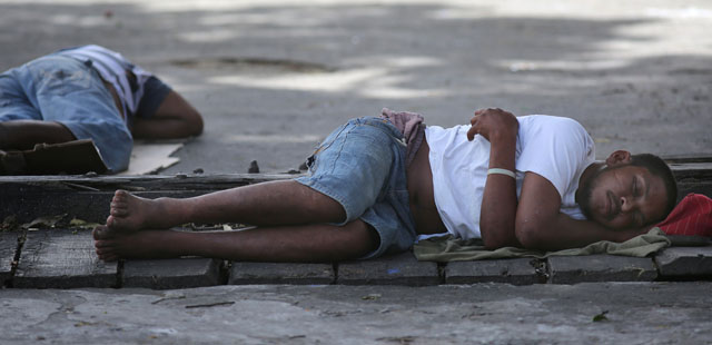 Men sleep on a sidewalk in Georgetown, Guyana, March 14. The World Bank and global faith leaders are joining together to end extreme poverty around the world by 2030. (CNS photo/Bob Roller) See WASHINGTON LETTER April 10, 2015.
