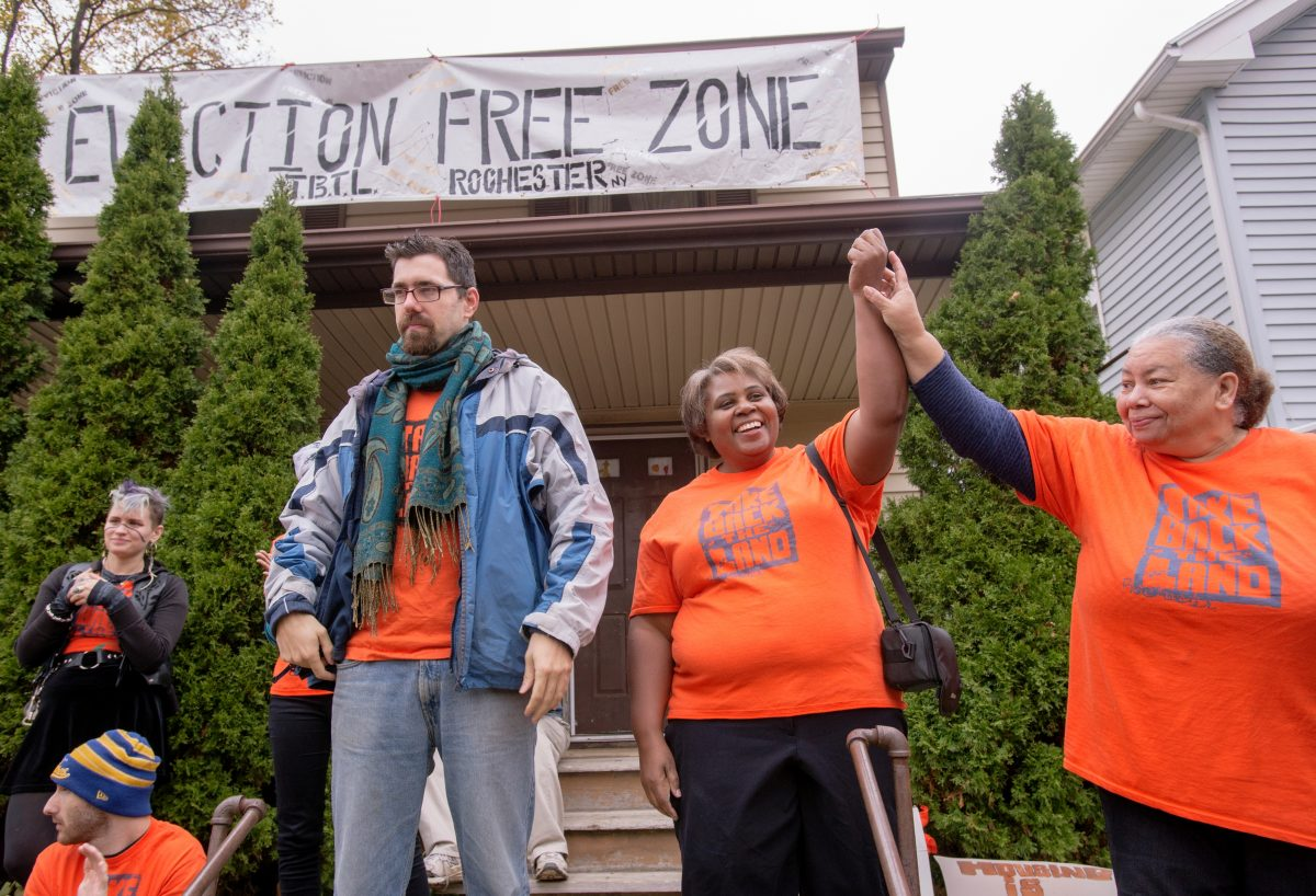 Take Back the Land organizer Ryan Acuff (left) stands with homeowner Elizabeth McGriff during the Nov. 10, 2015. rally against McGriff's eviction from her home.