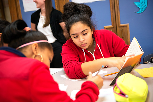 Eighth-grader Jashlyn Montes tutors a fellow student after school at Rochester's Eugenio Charter School Nov. 18.