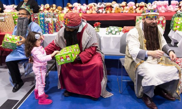 The Three Kings give out gifts during the Bilingual Education Council's celebration.