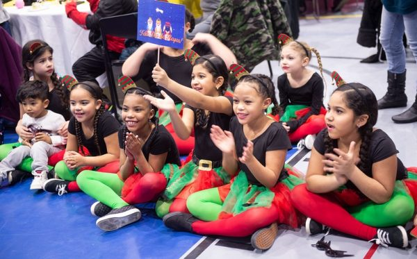 Children react as the Three Kings arrive during the Bilingual Education Council's Three Kings celebration.