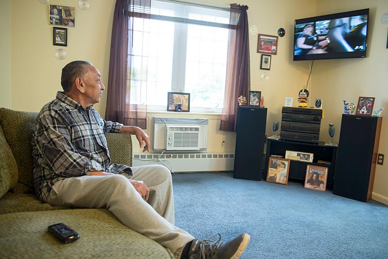 Ramon Torres watches tv in his Buena Vista senior apartment on June 27 in Rochester.El Mensajero Photo by John Haeger