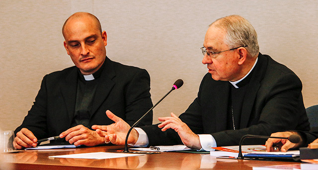 Archbishop Jose H. Gomez of Los Angeles, right, speaks alongside an unidentified clergyman during a meeting in Rome with U.S. Encuentro representatives Sept. 13, 2019. Encuentro representatives were in Rome to present findings from the Fifth National Encuentro to Pope Francis and Vatican officials. (CNS photo/USCCB) See VATICAN-GOMEZ-BISHOPS-ENCUENTRO Sept. 17, 2019.