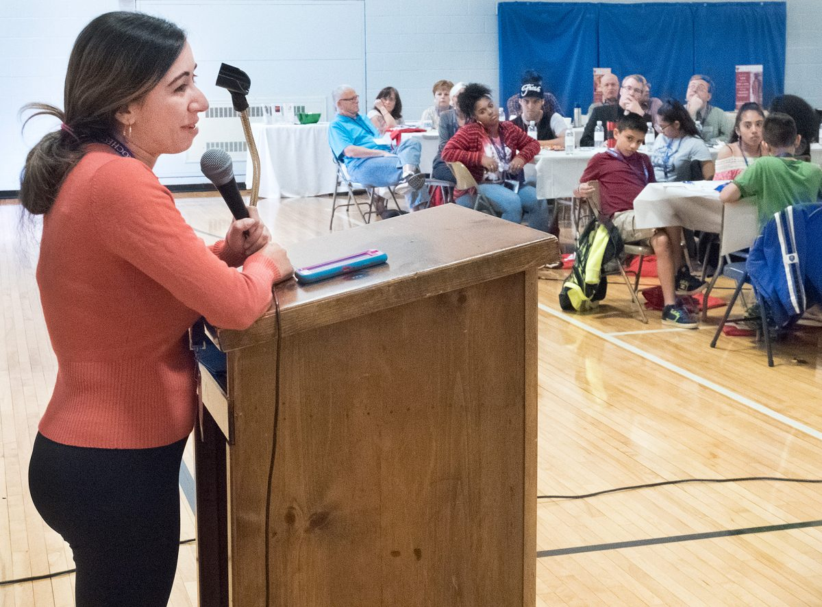 """Ana Carolina Torres a member of Nativity of the Blessed Virgin Mary, Brockport talks about """"Accompanying Everyone"""" during the diocesan conference on Encuentro experiences on Oct. 21 in Rochester."""