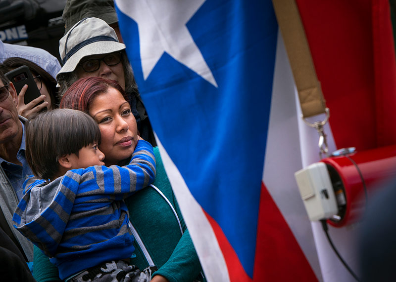 Blanca Rodriguez holds her son during the demonstration on Sept. 8.
