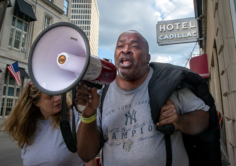 A protestor leads a march down in front of the Hotel Cadillac in Rochester with members of the Rochester Homeless Union and its supporters during a demonstration Oct. 9. The supporters marched from the hotel to the Monroe County Executive Building.