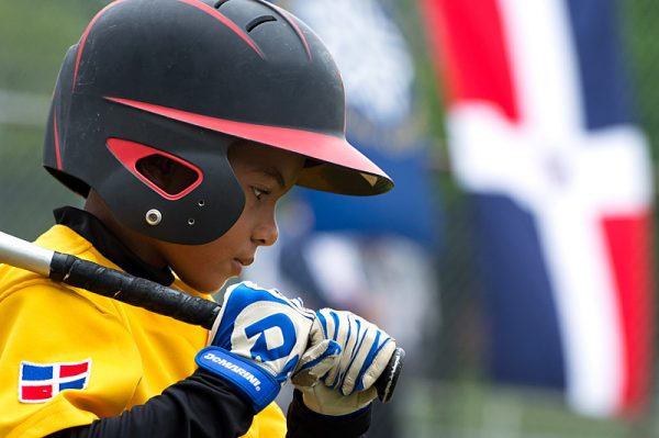Wendell Esteve Polanco Fabián, a baseball player from the Dominican Republic, takes some practice swings before his turn at bat during a July 22 game at Rochester's Baden Park.