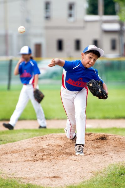 Rochester player Alex Rosado throws a pitch during the game.