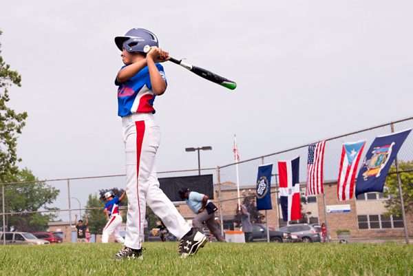Rochester player Angel Nunez takes some practice swings before his turn at bat.