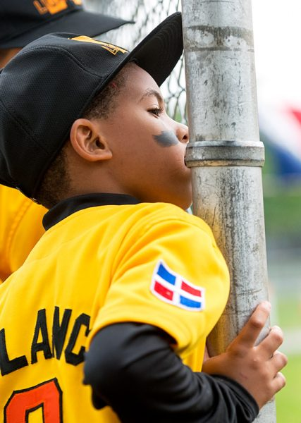 Wendell Esteve Polanco Fabián watches the game from the bench.