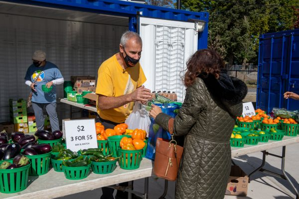 Nick Mendola sells produce at Wilson's produce stand.