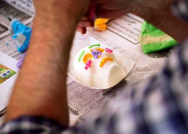 An attendee decorates a sugar skull during the celebration.
