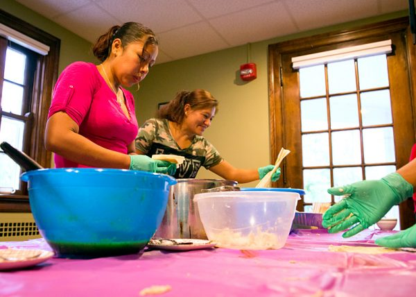 Martha Aguilar and Blanca Rodriguez prepare tamales during the celebration.