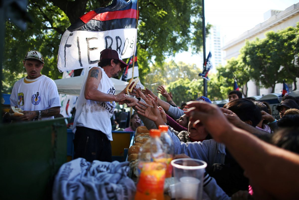 Union members hand out free food for demonstrators, the homeless and unemployed, during a May Day protest against the government of Argentina's President Mauricio Macri, in Buenos Aires, Argentina, May 1, 2019. The social ministry of the Argentine bishops' conference has urged the government to declare a food emergency as the country's economy careens into crisis. (CNS photo/Agustin Marcarian, Reuters) See ARGENTINA-BISHOPS-FOOD-EMERGENCY to come.