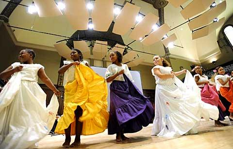 Students perform traditional Puerto Rican folk dances.