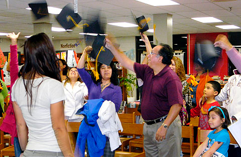 A group of parents trained by Conexion Americas, an National Council of La Raza affiliate that provides support to Latino immigrants in Nashville, Tennessee, celebrate during their Nov. 2011 graduation.